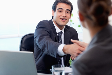 opportunity: Smiling manager interviewing a female applicant in his office