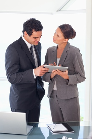 salespeople: Young business partner working on tablet together Stock Photo