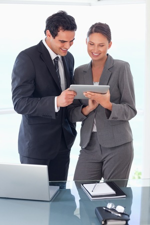 salespeople: Young trades partner looking at tablet in their hands