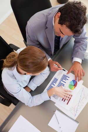 Above view of young business people analyzing data Stock Photo - 11687621