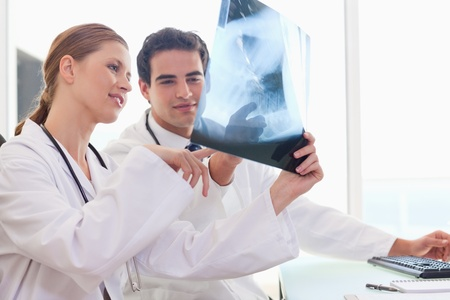 Young doctors talking about an x-ray Stock Photo - 11716762