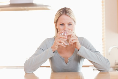 sip: Young woman having a sip of water Stock Photo