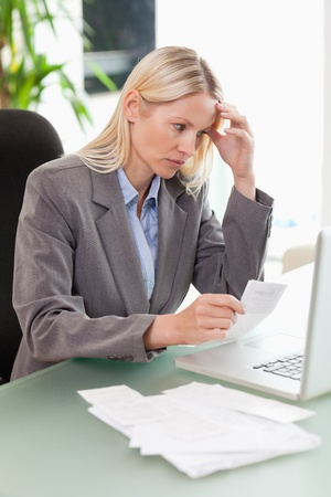 Worried businesswoman doing accounting Stock Photo - 11687702