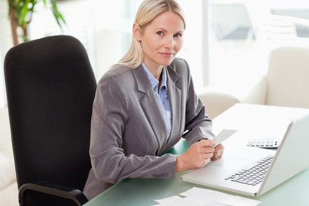 Side view of young businesswoman doing her accounting Stock Photo - 11716265