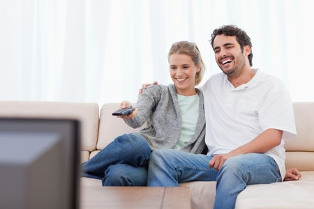 Couple watching TV in their living room Stock Photo - 11683601