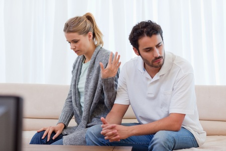 argument from love: Woman being mad at her fiance in their living room Stock Photo