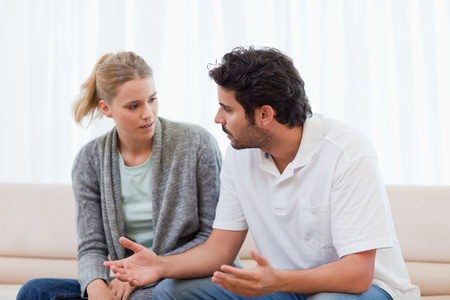 Man being mad at his wife in their living room Stock Photo - 11685103