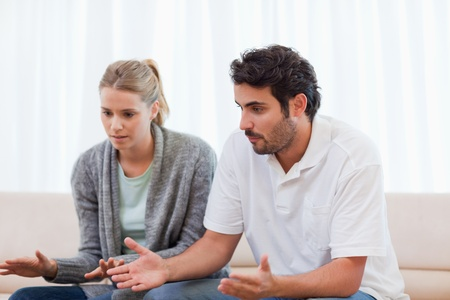 Angry man being mad at his wife in their living room Stock Photo - 11685325