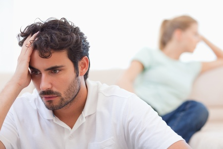 Couple mad at each other in their living room Stock Photo - 11685829