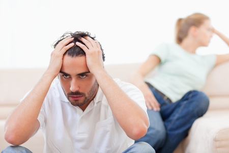 Angry couple mad at each other in their living room photo