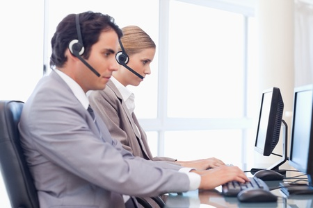 Young operators using a computer in a call center