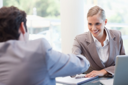agency agreement: Manager interviewing a male applicant in her office Stock Photo