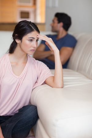 Portrait of a young couple after an argument in their living room photo