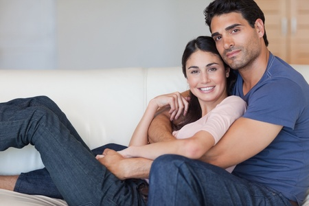 Lovely young couple posing in their living room photo