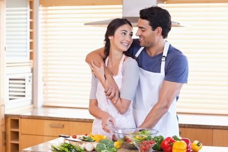 Lovely young couple posing in their kitchen photo