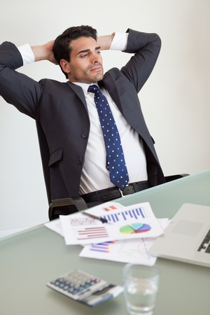 Portrait of a relaxed sales person in his office photo