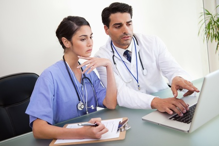 doctor computer: Young doctors working with a notebook in an office Stock Photo