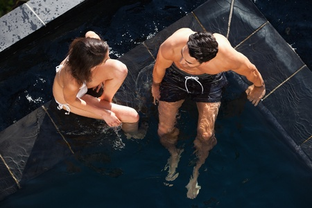 Above view of a couple talking in a swimming pool photo