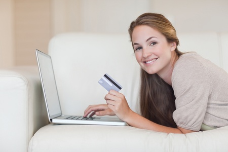 happy shopping: Woman shopping online in her living room Stock Photo