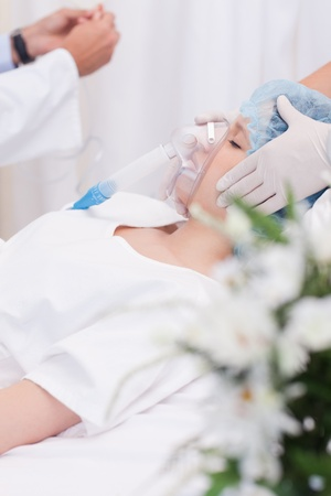anesthesia: Young woman in the intensive care unit Stock Photo