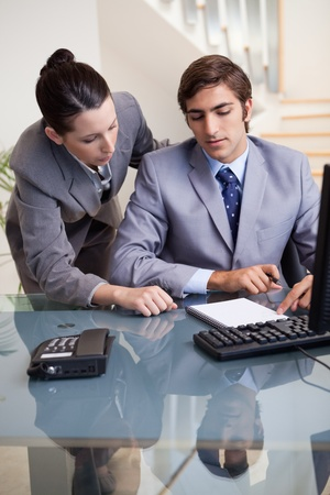 Young businesswoman mentoring her new colleague photo