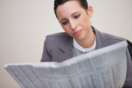 Young businesswoman reading stock report photo