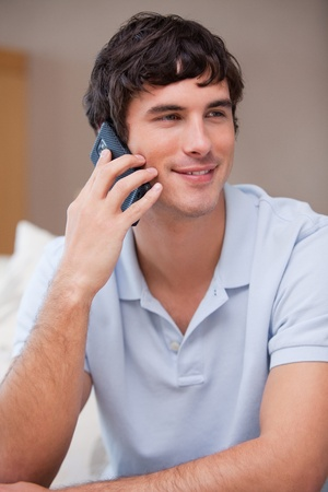 phonecall: Young man answering phonecall Stock Photo