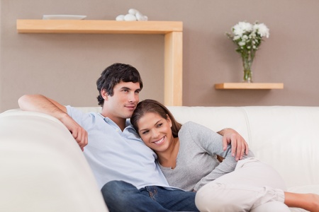 Young couple being together on the sofa photo