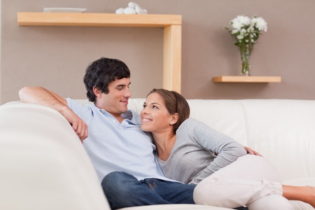 Young couple on the sofa in love photo