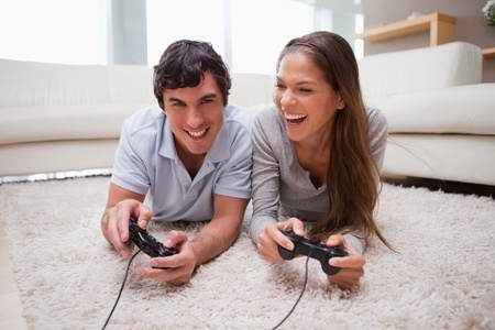 game room: Young couple playing video games together