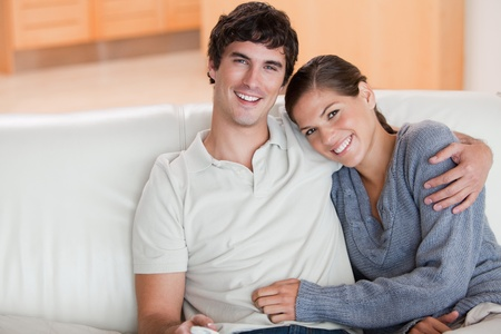 woman couch: Happy young couple enjoying their time together on the couch Stock Photo