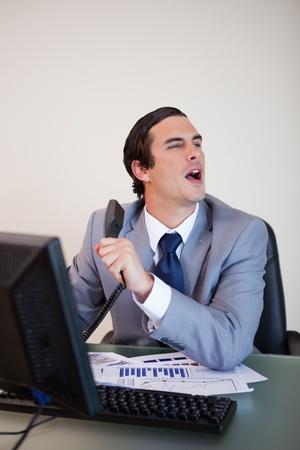 caller: Businessman asking colleague for information his caller needs Stock Photo