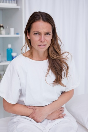 Woman having really bad stomachache photo