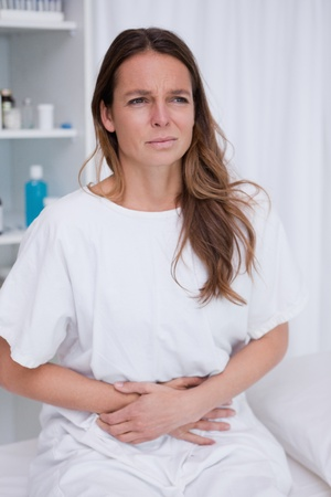 Woman having terrible belly ache photo