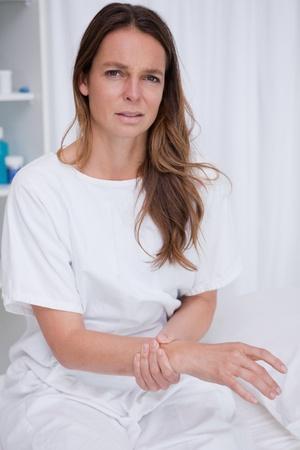 cut wrist: Woman in the hospital feeling her pulse Stock Photo