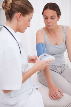 Doctor measuring patients blood pressure Stock Photo - 11684953