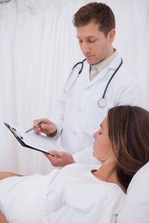 Doctor explaining his bedridden patient the examination results Stock Photo - 11685910