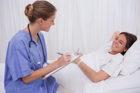 Surgeon talking with bedridden patient Stock Photo - 11683921