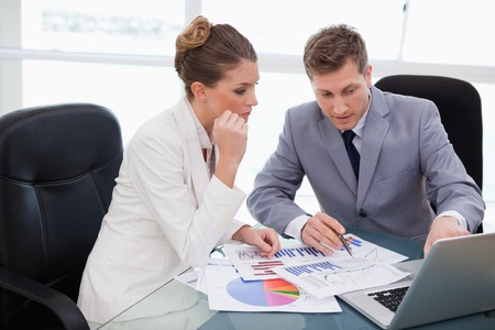 Business team analyzing market research data Stock Photo - 11683823