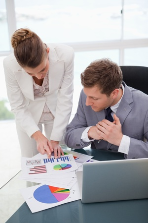 Businesswoman explaining research results to colleague photo
