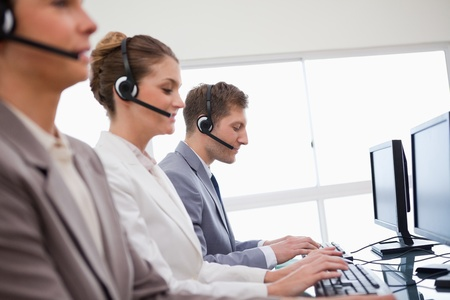 Side view of customer advisory service at work