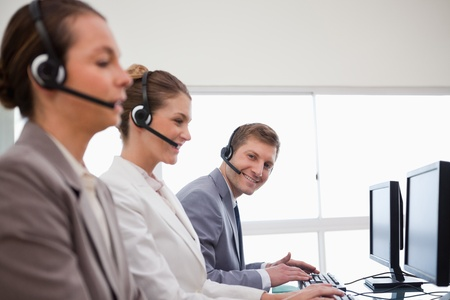 Side view of call center team at work photo