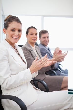 Side view of employees applauding after presentation Stock Photo - 11686009