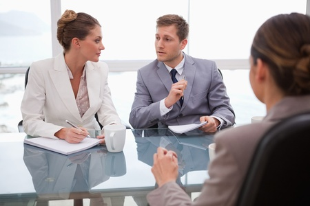 negotiation business: Business team deliberating with their lawyer