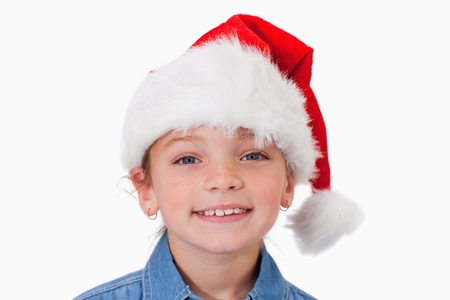 Girl with a Christmas hat against a white background photo