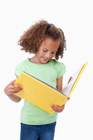 Portrait of a girl reading a fairy tale against a white background Stock Photo - 11686768
