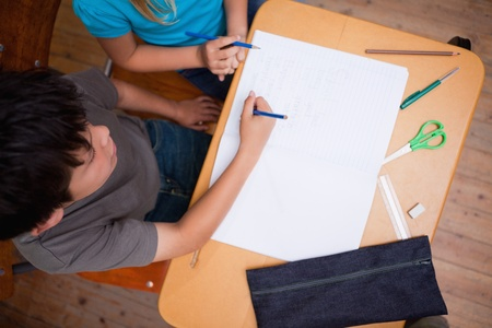 Above view of pupils working together in a classroom photo