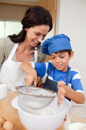 Mother and son baking together photo