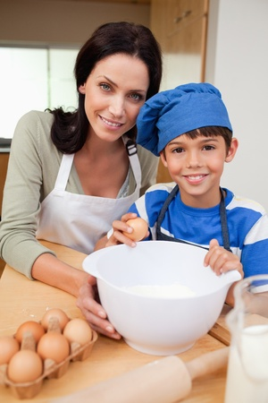 Son and mother baking cake together Stock Photo - 11682673