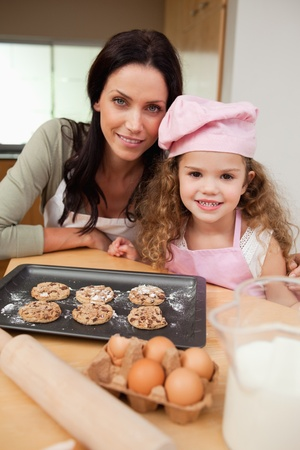 Mother and daughter together with cookies photo